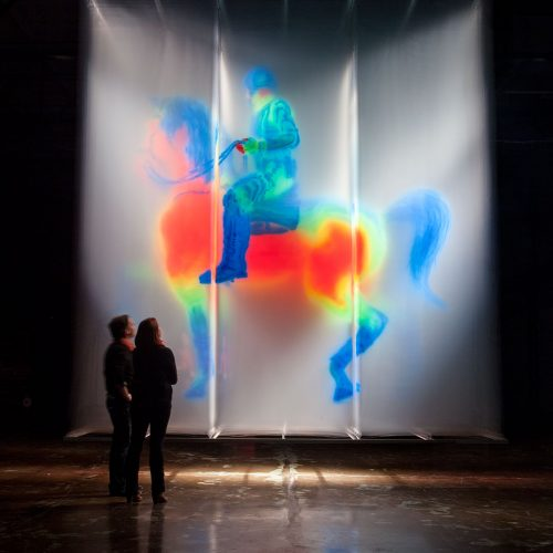 David Spriggs. Regisole - Sun King. 2015 Dimensions: 479 x 184 x 579 cm / 188.5 x 72.5 x 228 inches 3D installation artwork, acrylic spray paint on layers of transparent film, springs, t-bars, lighting. Digital modelling by Ian Spriggs.