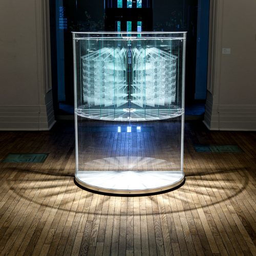 2014 120 x 66 x 158 cm / 47.5 x 26 x 62.5 inches Layered engraved tempered glass sheets in half column display case